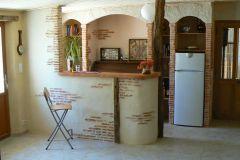 7- Relooking salon avec bar décoratif